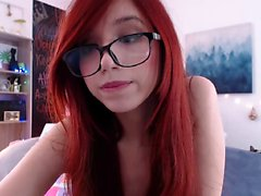 Redhead teen with glasses striptease