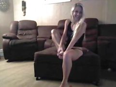 Cute blonde is on her webcam for the first time and strips