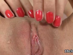 Lovely nympho is gaping tight snatch in close-up and having