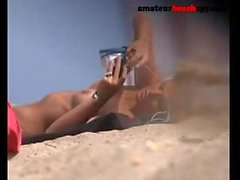 Topless beach girl exposed by hidden camera