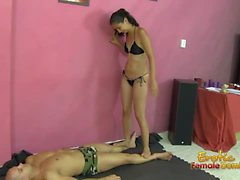 Cute domme trampling her slave into submission