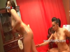 Busty lesbians Eva May and Veronica fisting