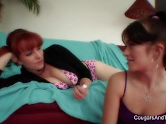 Redheaded MILF teaches young brunette how to fuck