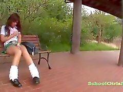 Hot Busty Schoolgirl Masturbating Using Vibrator On The Bench Outside In The Schoolgarden