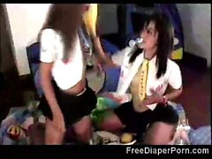 2 Naughty schoolgirls go nasty as they wear diapers