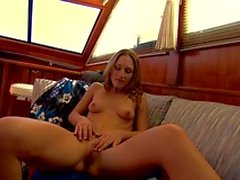 Brunette slut gets randy on a boat and fingers her pussy solo