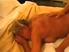Granny cougar having sex with a young stud
