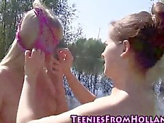 Teen babes go outside to suck the sweet pussy up