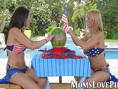 Attractive MILF and teen have steamy lesbian sex by the pool