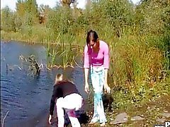 Young babes masturbate by the river