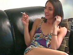 Sexy brunette teen smoking
