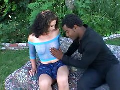 Beautiful brunette teen flashes her lovely tits and sucks a black dick
