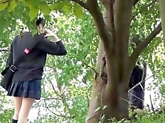 Asian teens piss outside
