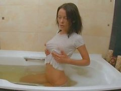 Sweet teen beauty in bath tube
