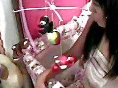 Hot Chinese teen puts her hand under her diapers to please herself