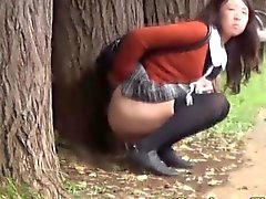Asian teen squats to piss in public