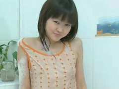 Cute young Asian Aliona plays alone in the bathtub to