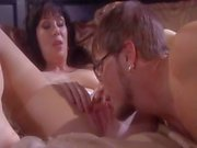 Nasty brunette mom seduces her son's young friend for hot sex