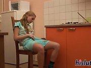 Sexy cutie masturbates in the kitchen
