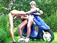 Teen fucked outdoors on a scooter