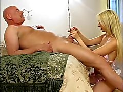 Bikini blonde kneels to give bald dude long rub-n-tug