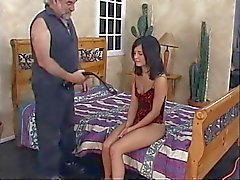 Ponytailed dude fingers miniskirted b-cup brunette's pussy and spanks her ass