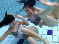 Skinny brunette teens skinny dipping lustily