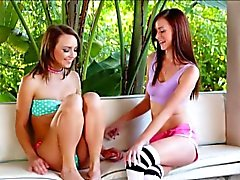 Two sweet teen girls Carmen and Jayden making out outdoors