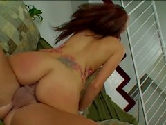 Redhead babe getting fucked on the couch.