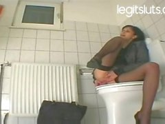 My personal secretary masturbates with dildo at the restroom