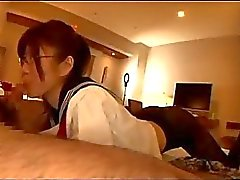 Schoolgirl With Glasses Pantyhose Sucking Guy Cock Giving Footjob Cum To Legs On The Bed In The Room