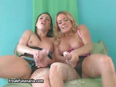 Two sexy babes love jerking their huge part1