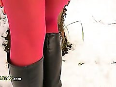 Red nylon pantyhose in winter forest