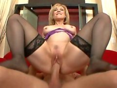 Nasty MILF Nina Hartley fingers her flange before being fucked by a young prick