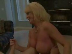 Mature blonde handjob