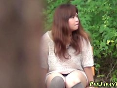 Sneaky asian teen pees