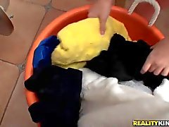 Young Amy Anderson flashes her ass at the laundry