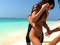 A asian teen has groupsex outdoors on the beach