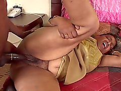 Black granny sucks and gets fucked by a young stud