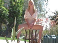 blonde babe is in the outdoors wanking on her wet cunt
