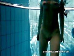 Redheaded Mia stripping underwater
