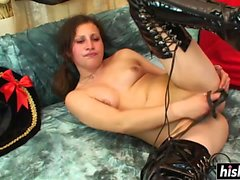 Horny slut in latex boots masturbates