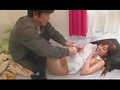 Yuu Asakura strips for this chubby guy and gives him a blowjob