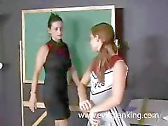 MILF spanking schoolgirl ass
