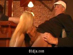 Daring blonde sucks two old dicks