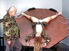 Young blonde slave gets strapped in a spinning wheel