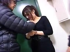 Young Asian cutie in a black dress kneels to give a blowjob