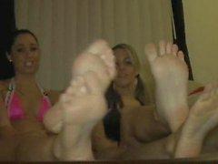 Two pretty girls show their feet
