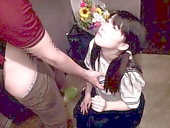 Japanese teen in schoolgirl uniform tittyfucked in hallway