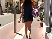 Following little brunette in street with hidden cam
